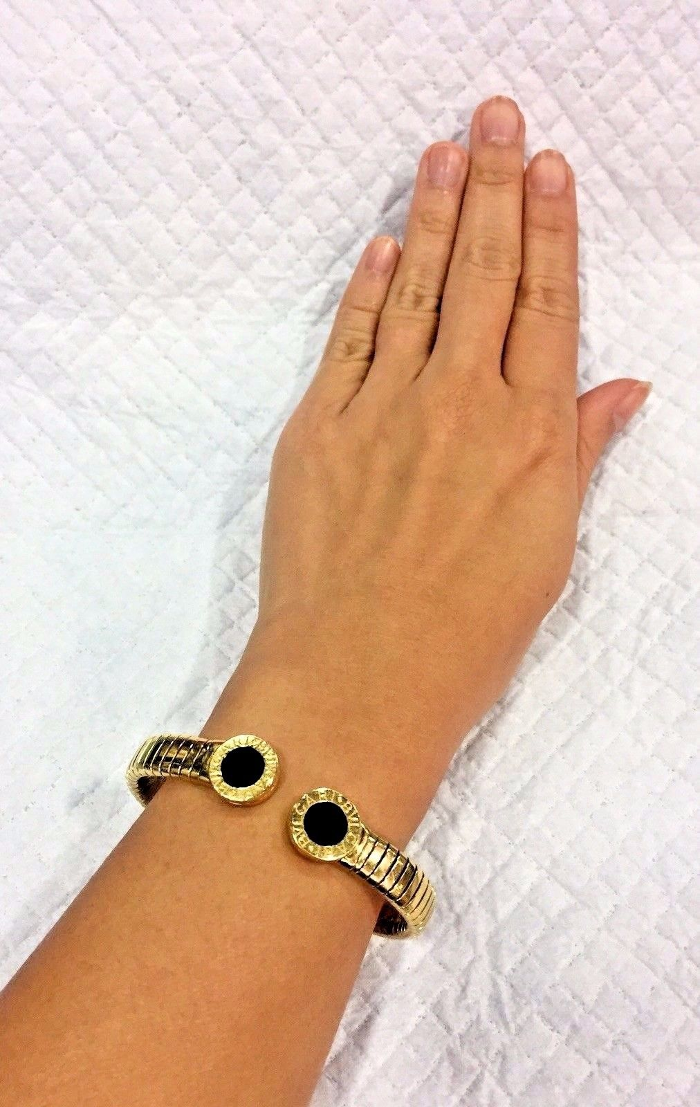 27f4fddc59f6c Estate Bvlgari Tubogas Bracelet in onyx and 18K yellow gold ...